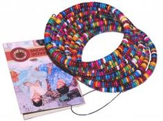 These colorful fair trade slinky bracelets are made from tiny resin beads strung on a coil. The artisans polish the resins to create beads of different shapes and sizes. A great everyday accessory and a charming addition to casual outfits. $20. http://www.craftmontaz.com/products/beaded-bracelets-info.html