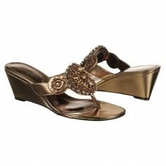 Sitting here this morning trying to decide if I want to order these dark brown metallic wedge sandals for summer.