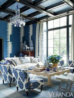 Blue and white ikats, arabesques, chevrons, and stripes are unified through tint and tone in this living room by Kelli Ford and Kirsten Fitzgibbons.