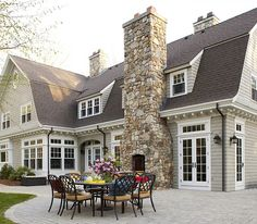 I like the white and soft taupe exterior. Who wouldn't love an outdoor fireplace too? The stone adds awesome texture.