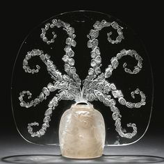 "René Lalique ""VÉRONIQUE"" VEILLEUSE, MARCILHAC NO. 2565 engraved Lalique molded and frosted glass 8 1/8 in. (20.6 cm) high model introduced 1913."