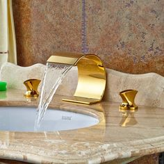 Creative Design Waterfall Bathroom Basin Faucet Dual Handles Vanity Sink Mixer Tap Gold Finish Type: Basin FaucetsBrand Name: ROZINStyle: ContemporaryHot & Cold Water: YesNumber of Handles: Single HandleSurface Treatment: Ti-PVDStyle: Single Holder Si Bathroom Sink Design, Bathroom Basin, Bath Taps, Washroom, Bathroom Fixtures, Home Interior Design, Interior Decorating, Gold Taps, Photo Deco