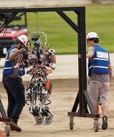 (AP Photo/Alex Gallardo). Virginia Tech College of Engineering members take their  robot, Escher, to the beginning of the course during the first stage in the U.S. Defense Advanced Research Projects Agency Robotics Challenge in Pomona, Calif., Friday, ...