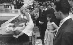 NYC. Marilyn Monroe surrounded by fans at Fifth Avenue just in front of The Plaza Hotel June 12th, 1957 by Sam Shaw.