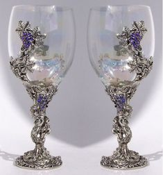 Crystal grapes hang in bunches from the delicately twisting vine.Whatever you're sipping tastes better from this elegant glass. We makeit by hand from lead-free pewter, Austrian crystals, and fine glass. Itwill hold 12 ounces when filled to the brim. Wedding Toasting Glasses, Bridal Glasses, Wedding Flutes, Champagne Glasses, Wedding Toast Samples, Best Man Wedding Speeches, Diy Wedding Flowers, Wedding Ideas, Purple Wedding