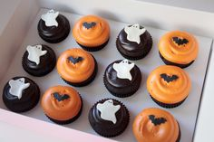 Halloween Cupcakes (Georgetown Cupcake). Wish I had little bat and ghost cutters for fondant.