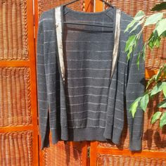 Grey and Bronze Cardigan Grey cardigan with bronze metallic stripes and bronze sequins down front.  Love this with jeans! 50% acrylic, 48% wool, 2% metallic fibers Sweaters Cardigans