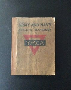 "Army and Navy Handbook from YMCA Bureau of War Work, New York 1919. Part of the Y's WWI efforts and important YMCA history.  Book is about 5"" tall, would have fit in pockets on uniform of American YMCA Secretaries sent to the Western Front to run canteens and recreation programs."