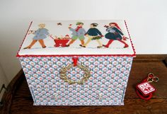 my sewing box made wit drawers and with crossstitch cover