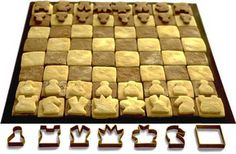 Here's a chess set that looks good enough to eat -and you can! Designer Biggles made cookie cutters in the shapes of various chess pieces. When you take your opponent's pieces, they could be gone forever.