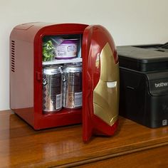 This Iron Man Mini Fridge will help you quench your thirst. It is a molded Iron Man with light-up eyes, but the best part is that it keeps your drinks cold. Iron Men, Marvel Bedroom, Home Music, Tv Wand, Marvel Gifts, Stark Industries, Geek Decor, Cool Inventions, Man Cave