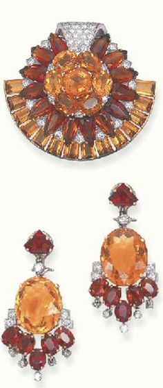 *A SET OF CITRINE AND DIAMOND JEWELLERY, BY CARTIER Comprising a clip brooch, designed as a sunflower set with vari-cut two-toned citrines, enhanced by circular-cut diamond detail to the rectangular-cut citrine crescent trim; and a pair of ear pendants en suite, mounted in 18k gold and platinum, circa 1950 Signed Cartier, London