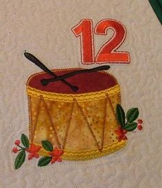 Advanced Embroidery Designs. Free Projects and Ideas. 12 Days of Christmas Tree Skirt with machine embroidered applique.