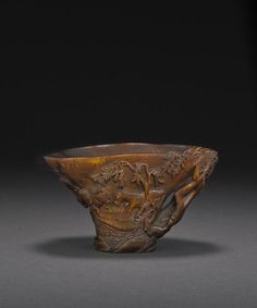 A rhinoceros horn libation cup carved with a groom and horses, 17th century