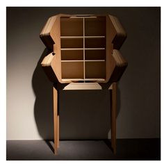 Accordion cabinet in oiled beech wood, maple, pear and pine; designed by Elisa Strozyk and Sebastian Neeb.