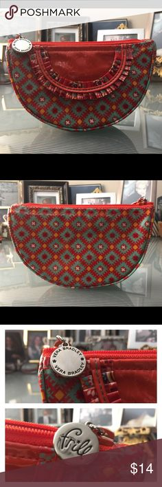 Frill pouch from Vera Bradley Never used pouch from Vera Bradley. Color is red-orange with gold and sage green accents. Has been stored away long enough. Vera Bradley Bags Cosmetic Bags & Cases