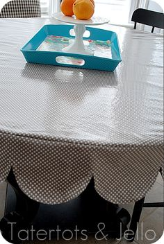 Make a super durable tablecloth out of laminated fabric. It wipes off easily and looks great all the time. I'm sharing a tutorial on how to make a tailored, sleek tablecloth with a scalloped skirt. Diy Sewing Projects, Sewing Hacks, Sewing Tutorials, Sewing Crafts, Tutorial Sewing, Sewing Tips, Craft Projects, Oilcloth Tablecloth, Tablecloth Fabric