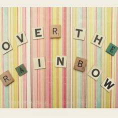 pick up a scrabble game from a thrift store and use the letters to make signs with scrapbook paper then frame it!