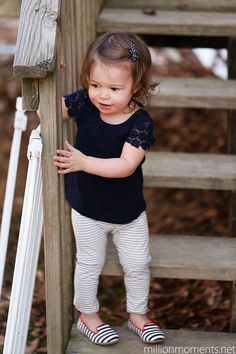 Black t-shirt with lace short sleeves and striped pants and shoes. | A Million Moments