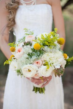 Probably one of my all-time favorite bridal bouquets... fresh succulents, bright yellow billy balls, ranunculus, & sweet, pink Juliet roses.  #preserveyourflowers