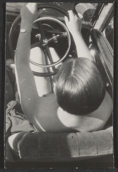 Franz Roh - Contact print from single Leica negative nude woman in driver's seat of car from above, 1927-1933