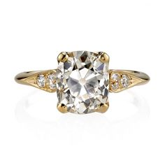 2.86ct OP/SI1 Cushion cut diamond EGL certified and set in a handcrafted 18K yellow gold mounting.