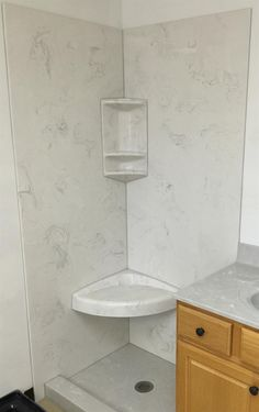 Shower base in standard color: Ice Gray, and walls in standard color: White with Ice Gray. With Corner Combo and Shower Seat