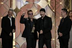 """They're no ordinary band. GRAMMY winners Adam Clayton, Bono, The Edge, and Larry Mullen Jr. of U2 take home Best Original Song honors for """"Ordinary Love"""" from Mandela: Long Walk To Freedom at the 71st Annual Golden Globe Awards on Jan. 12 in Beverly Hills, Calif."""
