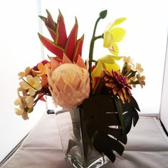 Polymer clay tropical flower arrangement by Manon van Kempen