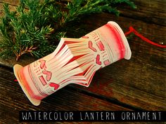 DIY Watercolor Paper Lantern Holiday Ornament - bet you could do a variation of this with a TP roll, too...