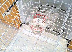 Place a dishwasher-safe cup filled with plain white vinegar on the top rack of the dishwasher. Using the hottest water available, run the dishwasher through a cycle – The vinegar will help wash away loose, greasy grime, sanitizes, and removes musty odor. Diy Cleaning Products, Cleaning Solutions, Cleaning Hacks, Cleaning Supplies, Cleaning Recipes, Cleaning Your Dishwasher, Kitchen Cleaning, Cleaning Room, Dishwasher Detergent