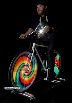 The Monkey Light Pro creates stunning hologram-like images and animations within a bicycle wheel. Once you're rolling, the display fills the bike wheel and is visible from both sides. The Monkey Light Pro is. Led, Pro Bike, Bicycle Painting, Motorized Bicycle, Bicycle Lights, Bike Light, Bicycle Wheel, Road Bike Women, Bike Seat