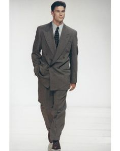 1990-1992 men's suits were double breasted with wide shoulders and pleated pants.  This look was popular until '97. (Kara P.)