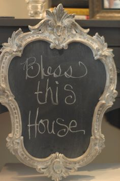 A nifty frame and a mirror; the back of the mirror was painted with chalkboard paint!!
