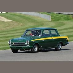 1963 Lotus Cortina Sold for £34,500 inc. premium. Another of my Dad's cars; green like this car but without the striping. My Mom crashed it, he was NOT happy-  >:|