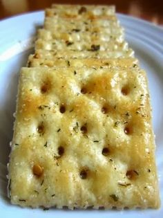 Fire Crackers 1 lb unsalted saltine crackers (4 sleeves) 1 cup canola oil 1 (1 ounce) packet ranch dressing mix 2 tablespoons crushed red pepper flakes 1/2 teaspoon garlic powder Directions: Line crackers on ends (like dominoes) in an air-tight container. Mix oil, dressing mix, peppers, and garlic powder. Spoon mixture evenly over crackers, like drizzling icing on a cake. Close lid tightly and flip the container over every 5 minutes for about 20 minutes. Store in a Ziploc bag.