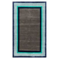 "Anchor your dining set or living room seating group in style with this lovely hand-tufted rug, showcasing a blue and turquoise border for stylish appeal.  Product: RugConstruction Material: PolyesterColor: Green, blue and neutralFeatures:  Hand-tuftedPlush pilePile Height: 0.47"" Note: Please be aware that actual colors may vary from those shown on your screen. Accent rugs may also not show the entire pattern that the corresponding area rugs have.Cleaning and Care: Vacuum regularly with ..."