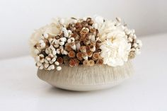 a low design mixed with small poppy pods, white tallow berries and soft creamy white preserved hydrangea blooms tucked into a low cement bowl with a textured rim. Flora Flowers, All Flowers, Dried Flowers, Hydrangea Not Blooming, Blooming Flowers, Lab, Modern Flower Arrangements, Flower Bowl, Organic Shapes