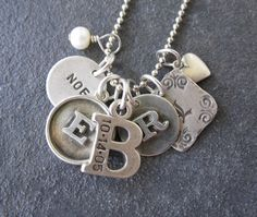Cutest Mom necklace! I'm not really a necklace lover but I think I would sport this, on a long chain.
