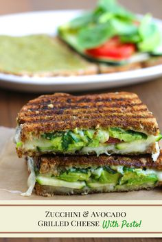A garlicky, crispy, grilled cheese sandwich that's stuffed with avocado, zucchini, tomatoes, spinach and pesto spread!