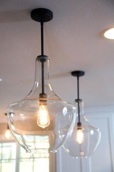 Two pendant lights along with recessed lighting illuminate a new kitchen island. Get more of your Fixer Upper fix.