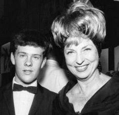 """On this night (8/27) in 1964 Agnes Moorehead attended the premiere of Walt Disney's """"Mary Poppins."""" The young man by Aggie is her adopted son Sean. Sean and Aggie had a tumultuous relationship that ended when Sean ran away from home in the late 60s. He hasn't been heard from since then."""
