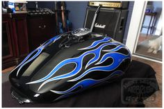 Painted by Taff Stephens at Next Level Airbrush in Jefferson, Georgia. This is a motorcycle tank that I painted kandy blue flames with a silver metallic pin striping with House Of Kolor paints and 6 coats of high solids clear coat. We water sand and buff all our motorcycle designs.