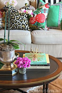 bold pillows in Mixed Prints paired with a neutral couch, white orchid, hot pink flowers