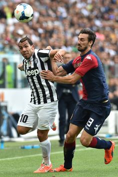 Carlos Tevez (L) of Juventus is challenged by Davide Astori of Cagliari Calcio during the Serie A match between Juventus and Cagliari Calcio...
