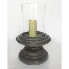 Conrete and glass hurricane lamp that would look great on an outdoor table