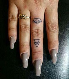 Lotus Flower Finger Tattoo. http://forcreativejuice.com/beautiful-finger-tattoo-designs/