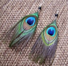 These beautiful earrings were crafted with love using natural peacock feathers and black glass beads. About 6 in length from the top of the surgical steel ear wires to the bottom of the feathers. Made to order. Please see my shop policies or shop announcement for current turn around