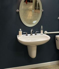 """Wall-mount sinks allow for easier wheelchair access. A tilted mirror provides better visibility from a chair as well. It's hard to identify this simple Contemporary design as an accessible one isn't it? For more on """"Aging (Stylishly) in Place"""": http://www.blog.riverbendhome.com/aging-in-place-stylishly/"""