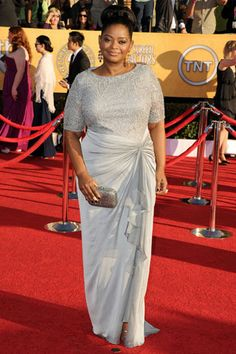Octavia Spencer, in Tadashi Shoji with Irene Neuwirth jewels and a Leiber clutch.